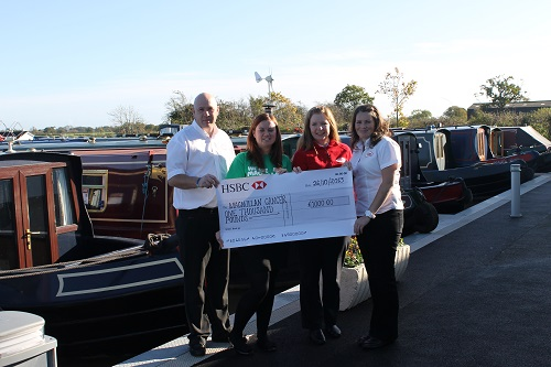sarah-page-macmillan-cancer-charity-collects-cheque-from-venetian-marina
